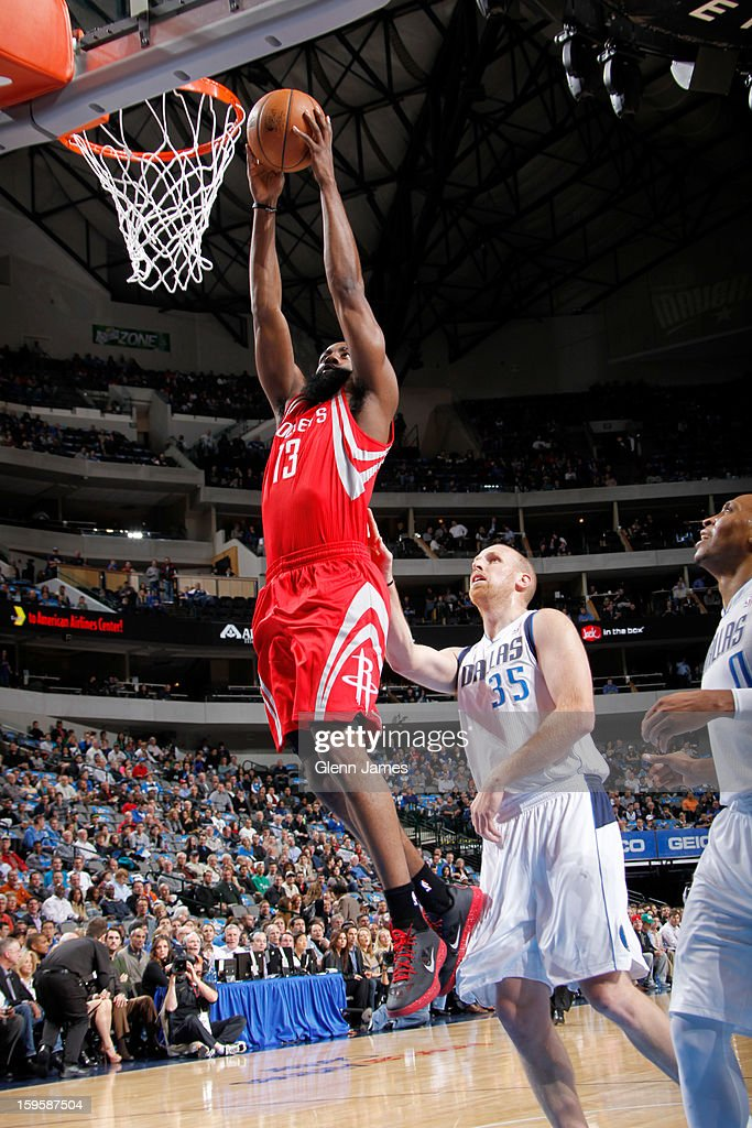 James Harden #13 of the Houston Rockets dunks against Chris Kaman #35 of the Dallas Mavericks on January 16, 2013 at the American Airlines Center in Dallas, Texas.