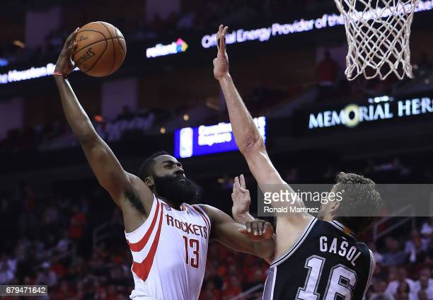 James Harden of the Houston Rockets dunks against Pau Gasol of the San Antonio Spurs during Game Three of the NBA Western Conference SemiFinals at...