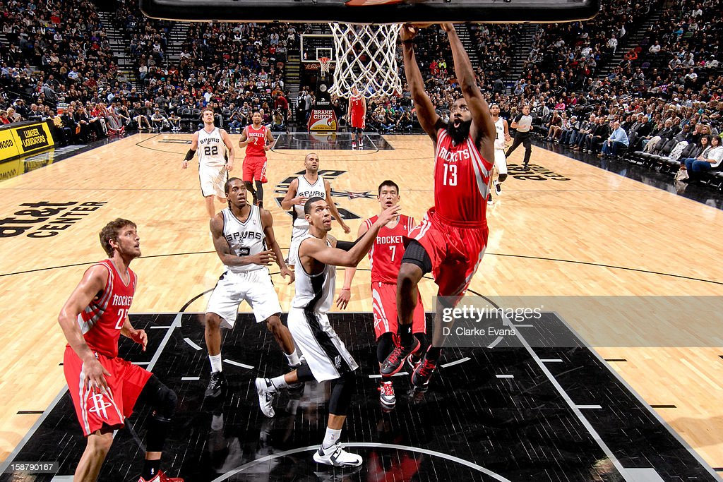 James Harden #13 of the Houston Rockets dunks against the San Antonio Spurs on December 28, 2012 at the AT&T Center in San Antonio, Texas.