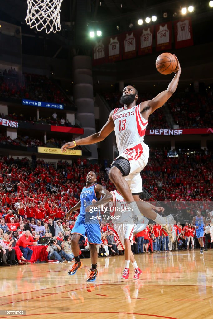 James Harden #13 of the Houston Rockets dunks on a fast break against the Oklahoma City Thunder in Game Four of the Western Conference Quarterfinals during the 2013 NBA Playoffs on April 29, 2013 at the Toyota Center in Houston, Texas.