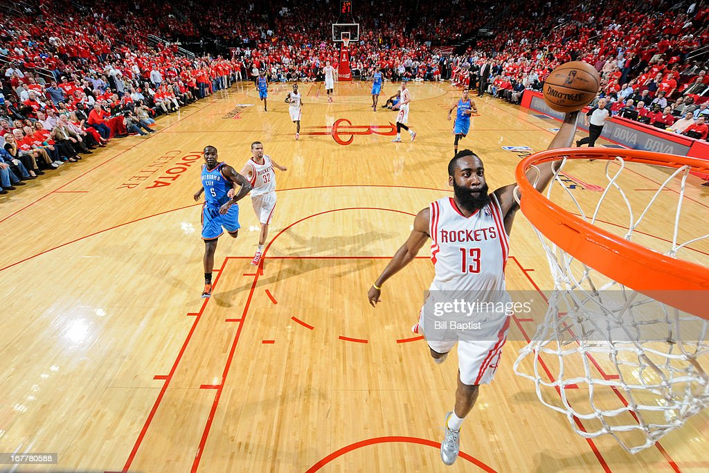 <a gi-track='captionPersonalityLinkClicked' href=/galleries/search?phrase=James+Harden&family=editorial&specificpeople=4215938 ng-click='$event.stopPropagation()'>James Harden</a> #13 of the Houston Rockets dunks on a fast break against the Oklahoma City Thunder in Game Four of the Western Conference Quarterfinals during the 2013 NBA Playoffs on April 29, 2013 at the Toyota Center in Houston, Texas.