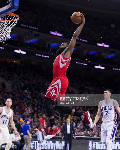 James Harden of the Houston Rockets dunks the ball past Ersan Ilyasova of the Philadelphia 76ers in the third quarter at the Wells Fargo Center on...