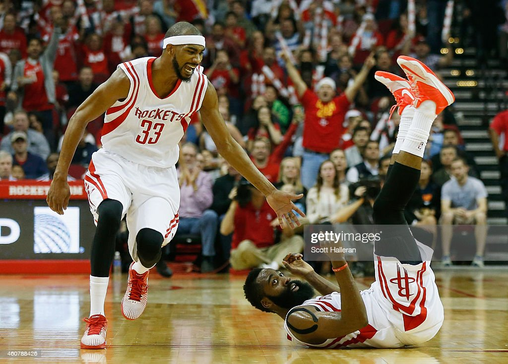 <a gi-track='captionPersonalityLinkClicked' href=/galleries/search?phrase=James+Harden&family=editorial&specificpeople=4215938 ng-click='$event.stopPropagation()'>James Harden</a> #13 of the Houston Rockets falls to the court in front of <a gi-track='captionPersonalityLinkClicked' href=/galleries/search?phrase=Corey+Brewer&family=editorial&specificpeople=234749 ng-click='$event.stopPropagation()'>Corey Brewer</a> #33 during their game against the Portland Trail Blazers at the Toyota Center on December 22, 2014 in Houston, Texas.