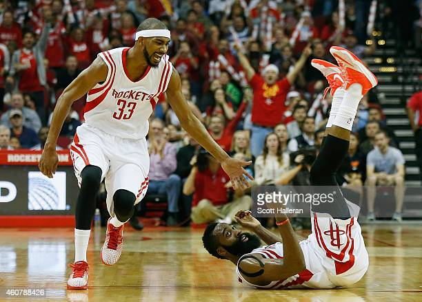James Harden of the Houston Rockets falls to the court in front of Corey Brewer during their game against the Portland Trail Blazers at the Toyota...