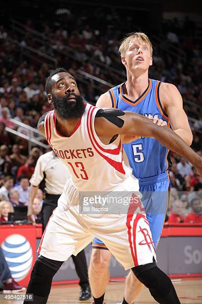 James Harden of the Houston Rockets fights for position against Kyle Singler of the Oklahoma City Thunder on November 2 2015 at the Toyota Center in...