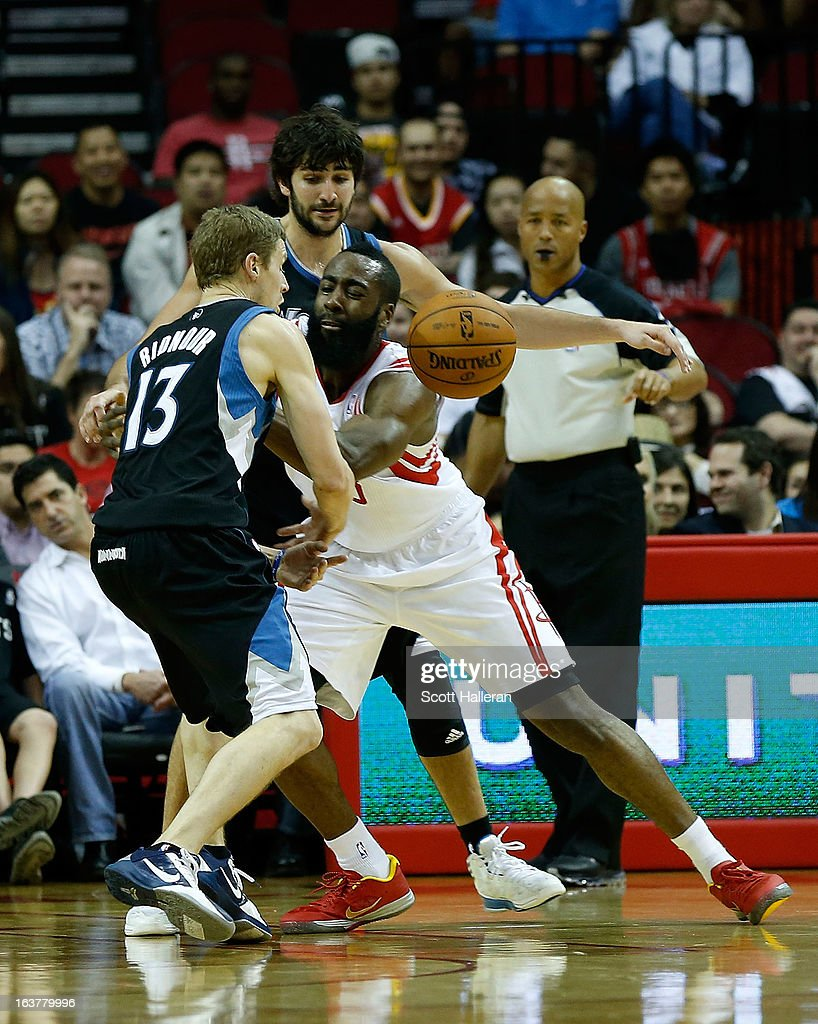 James Harden #13 of the Houston Rockets fights for the ball against Luke Ridnour #13 and Ricky Rubio #9 of the Minnesota Timberwolves at Toyota Center on March 15, 2013 in Houston, Texas.