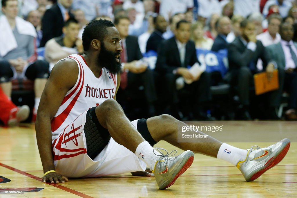 <a gi-track='captionPersonalityLinkClicked' href=/galleries/search?phrase=James+Harden&family=editorial&specificpeople=4215938 ng-click='$event.stopPropagation()'>James Harden</a> #13 of the Houston Rockets get knocked down to the court against the Oklahoma Thunder in Game Three of the Western Conference Quarterfinals of the 2013 NBA Playoffs at the Toyota Center on April 27, 2013 in Houston, Texas.