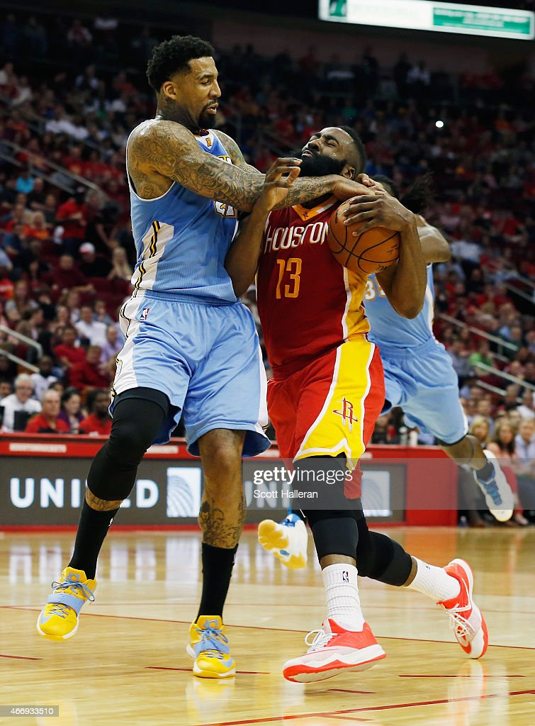 James Harden #13 of the Houston Rockets gets fouled by Wilson Chandler #21 of the Denver Nuggets during their game at the Toyota Center on March 19, 2015 in Houston, Texas.