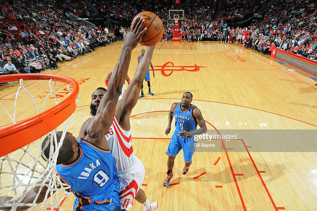 <a gi-track='captionPersonalityLinkClicked' href=/galleries/search?phrase=James+Harden&family=editorial&specificpeople=4215938 ng-click='$event.stopPropagation()'>James Harden</a> #13 of the Houston Rockets gets his shot blocked by <a gi-track='captionPersonalityLinkClicked' href=/galleries/search?phrase=Serge+Ibaka&family=editorial&specificpeople=5133378 ng-click='$event.stopPropagation()'>Serge Ibaka</a> #9 of the Oklahoma City Thunder on January 16, 2014 at the Toyota Center in Houston, Texas.
