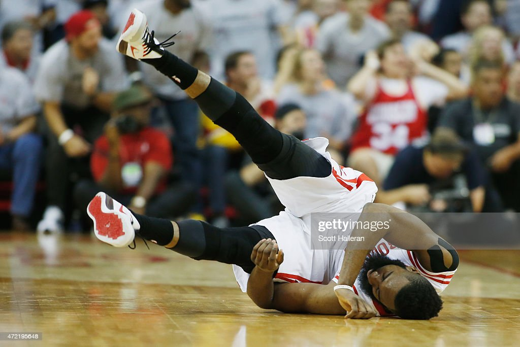 James Harden #13 of the Houston Rockets gets knocked down on the court against the Los Angeles Clippers during Game One in the Western Conference Semifinals of the 2015 NBA Playoffs on May 4, 2015 at the Toyota Center in Houston, Texas.