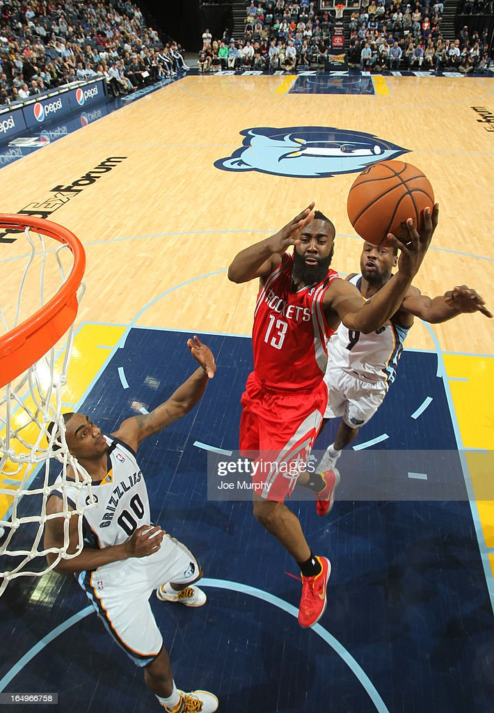 James Harden #13 of the Houston Rockets goes to the basket against Darrell Arthur #00 and Tony Allen #9 of the Memphis Grizzlies on March 29, 2013 at FedExForum in Memphis, Tennessee.