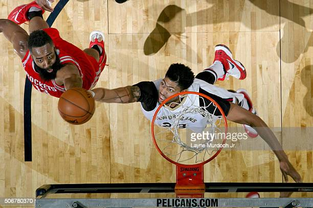 James Harden of the Houston Rockets goes to the basket against Anthony Davis of the New Orleans Pelicans on January 25 2016 at the Smoothie King...