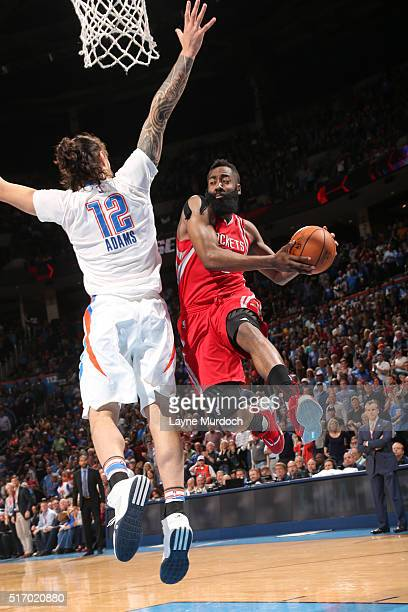 James Harden of the Houston Rockets goes to the basket against Steven Adams of the Oklahoma City Thunder on March 22 2016 at Chesapeake Energy Arena...