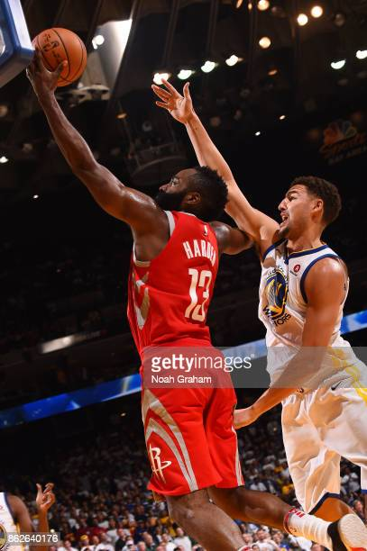 James Harden of the Houston Rockets goes to the basket against the Golden State Warriors on October 17 2017 at ORACLE Arena in Oakland California...