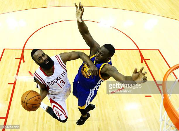 James Harden of the Houston Rockets goes up against Draymond Green of the Golden State Warriors in the second half during Game Four of the Western...
