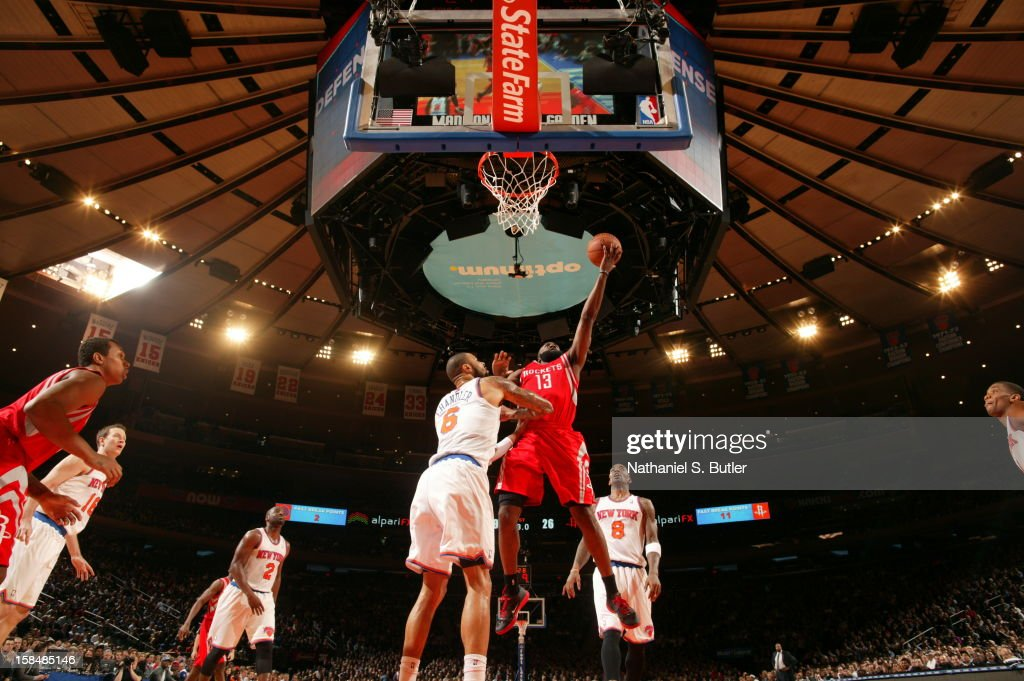<a gi-track='captionPersonalityLinkClicked' href=/galleries/search?phrase=James+Harden&family=editorial&specificpeople=4215938 ng-click='$event.stopPropagation()'>James Harden</a> #13 of the Houston Rockets goes up for a layup against <a gi-track='captionPersonalityLinkClicked' href=/galleries/search?phrase=Tyson+Chandler&family=editorial&specificpeople=202061 ng-click='$event.stopPropagation()'>Tyson Chandler</a> #6 of the New York Knicks on December 17, 2012 at Madison Square Garden in New York City.