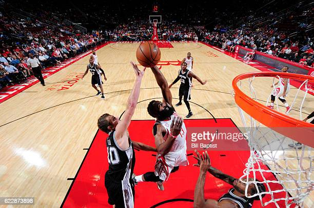 James Harden of the Houston Rockets goes up for a rebound during a game against the San Antonio Spurs on November 12 2016 at the Toyota Center in...