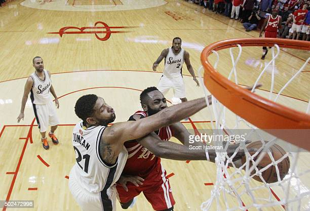 James Harden of the Houston Rockets goes up for a shot under Tim Duncan of the San Antonio Spurs during their game at the Toyota Center on December...