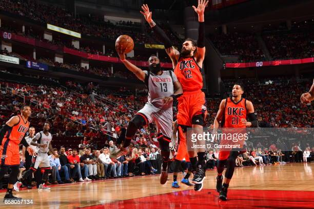 James Harden of the Houston Rockets goes up for the layup against the Oklahoma City Thunder on March 26 2017 at the Toyota Center in Houston Texas...