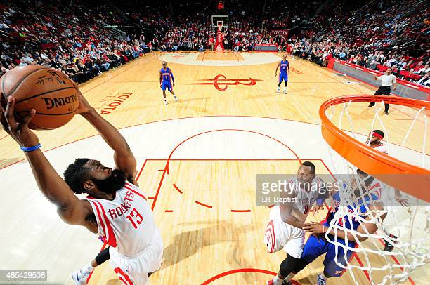 James Harden of the Houston Rockets grabs a rebound against the Detroit Pistons on March 6 2015 at the Toyota Center in Houston Texas NOTE TO USER...