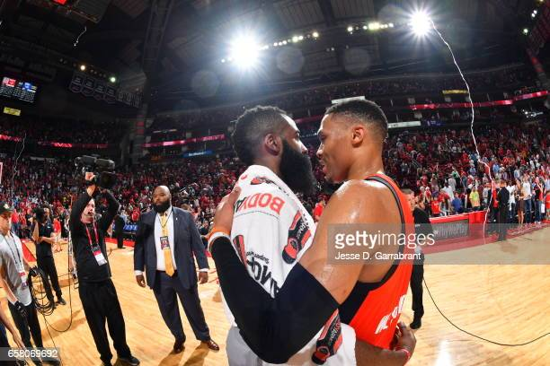 James Harden of the Houston Rockets greets Russell Westbrook of the Oklahoma City Thunder on March 26 2017 at the Toyota Center in Houston Texas NOTE...