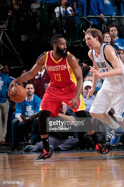 James Harden of the Houston Rockets handles the ball against Dirk Nowitzki of the Dallas Mavericks during Game Three of the Western Conference...