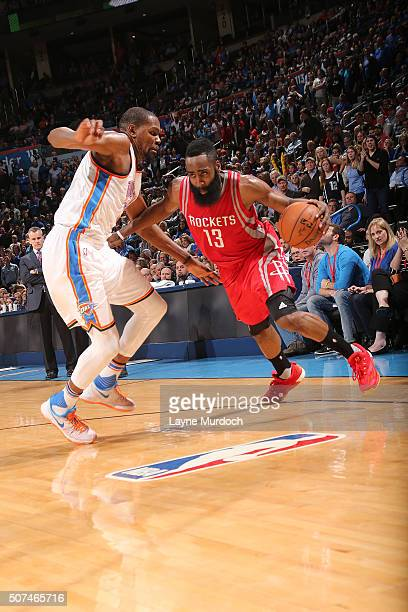 James Harden of the Houston Rockets handles the ball against Kevin Durant of the Oklahoma City Thunder on January 29 2016 at Chesapeake Energy Arena...