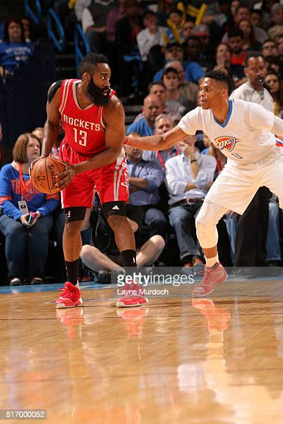 James Harden of the Houston Rockets handles the ball against Russell Westbrook of the Oklahoma City Thunder on March 22 2016 at Chesapeake Energy...