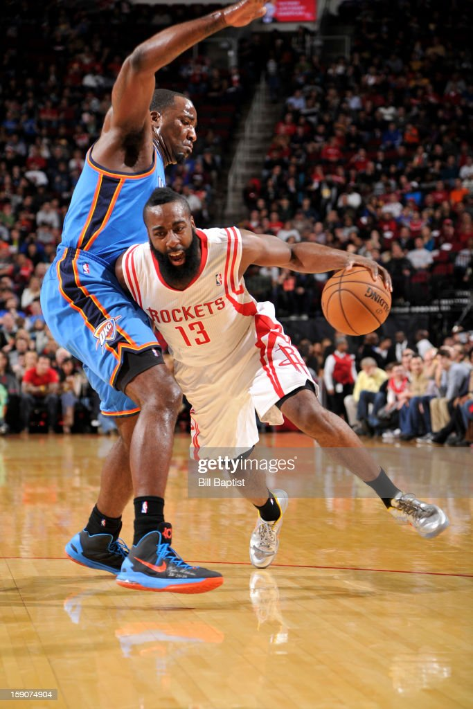 James Harden #13 of the Houston Rockets handles the ball against Serge Ibaka #9 of the Oklahoma City Thunder on December 29, 2012 at the Toyota Center in Houston, Texas.