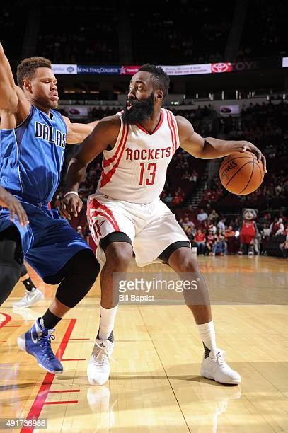 James Harden of the Houston Rockets handles the ball against the Dallas Mavericks during a preseason game on October 7 2015 at the Toyota Center in...