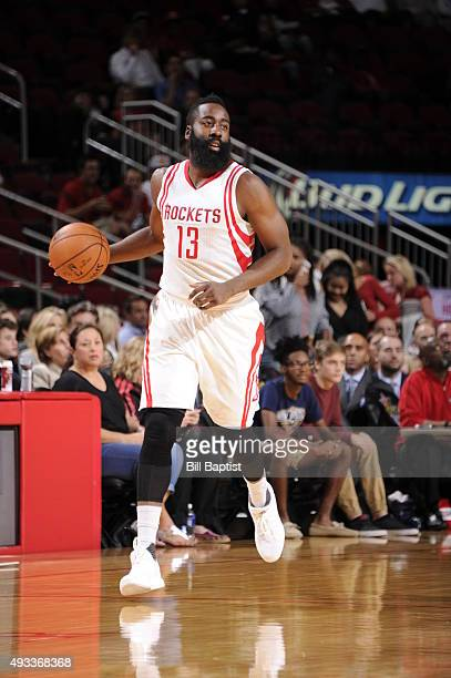 James Harden of the Houston Rockets handles the ball against the New Orleans Pelicans during a preseason game on October 19 2015 at the Toyota Center...