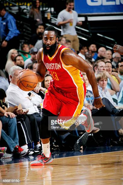 James Harden of the Houston Rockets handles the ball against the Dallas Mavericks on October 7 2014 at the American Airlines Center in Dallas Texas...