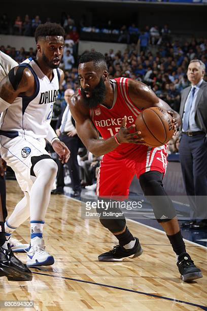 James Harden of the Houston Rockets handles the ball against the Dallas Mavericks on December 27 2016 at the American Airlines Center in Dallas Texas...
