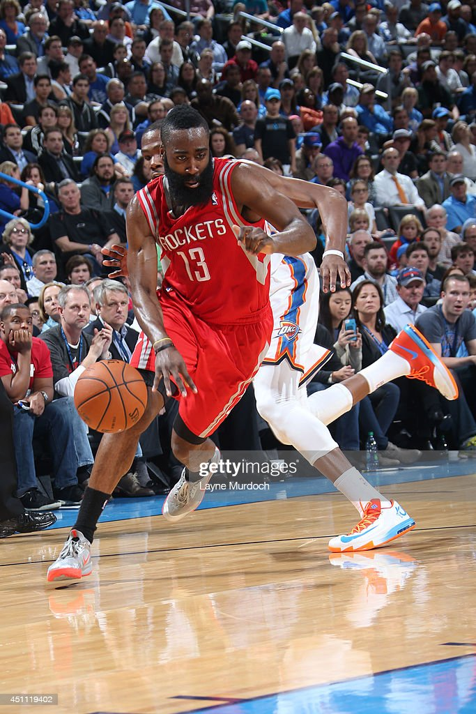 <a gi-track='captionPersonalityLinkClicked' href=/galleries/search?phrase=James+Harden&family=editorial&specificpeople=4215938 ng-click='$event.stopPropagation()'>James Harden</a> #13 of the Houston Rockets handles the ball against the Oklahoma City Thunder during an NBA game on March 11, 2014 at the Chesapeake Energy Arena in Oklahoma City, Oklahoma.