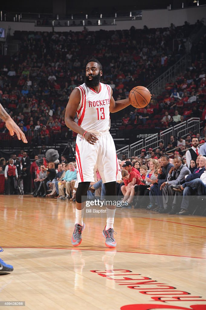 James Harden #13 of the Houston Rockets handles the ball against the Dallas Mavericks during the game on November 22, 2014 at the Toyota Center in Houston, Texas.