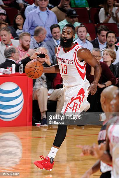 James Harden of the Houston Rockets handles the ball against the Portland Trail Blazers on November 18 2015 at the Toyota Center in Houston Texas...