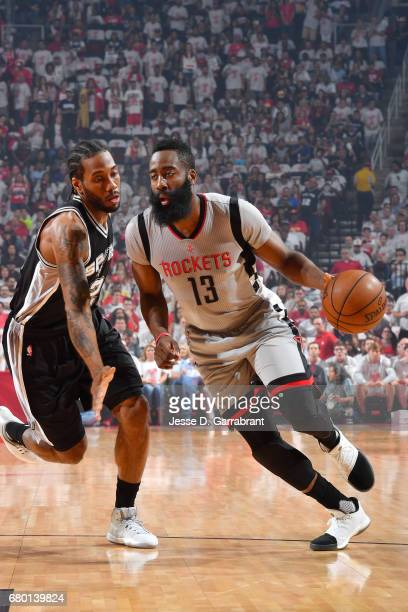 James Harden of the Houston Rockets handles the ball during the game against Kawhi Leonard of the San Antonio Spurs during Game Four of the Western...