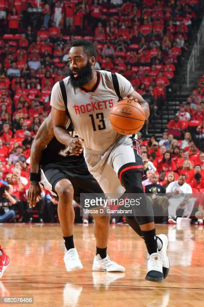 James Harden of the Houston Rockets handles the ball during the game against the San Antonio Spurs during Game Six of the Western Conference...