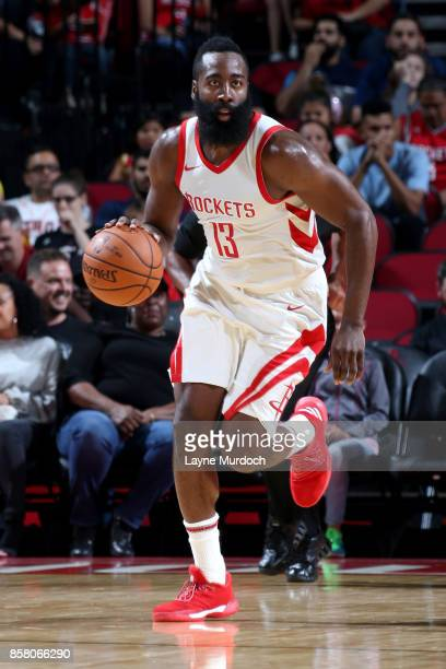 James Harden of the Houston Rockets handles the ball during the preseason game against the Shanghai Sharks on October 5 2017 at the Toyota Center in...