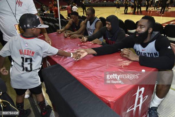 James Harden of the Houston Rockets interacts with a fan during the team's annual Fan Fest event on October 7 2017 at the Toyota Center in Houston...