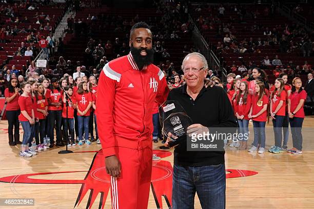 James Harden of the Houston Rockets is awarded the Kia Western Conference Player of the Month by Leslie Alexander before a game against the Los...
