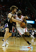James Harden of the Houston Rockets is fouled by Aaron Gray of the Sacramento Kings during the game at the Toyota Center on January 22 2014 in...