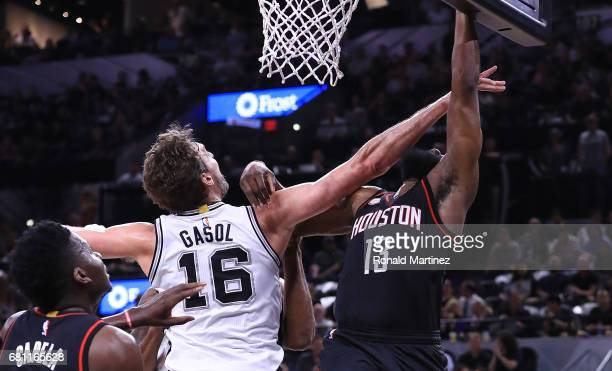 James Harden of the Houston Rockets is fouled by Pau Gasol of the San Antonio Spurs in the first quarter during Game Five of the Western Conference...