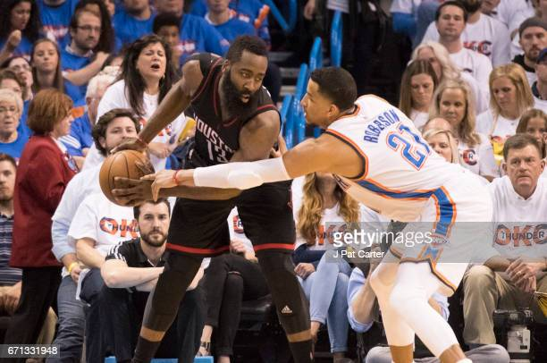 James Harden of the Houston Rockets keeps the ball away from Andre Roberson of the Oklahoma City Thunder during the second half of Game Three in the...
