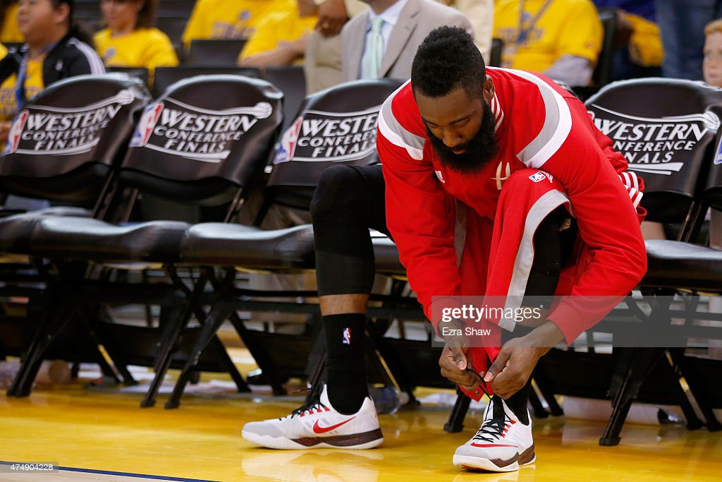 James Harden of the Houston Rockets laces up his NIKE shoes before the start of the second half against the Golden State Warriors during game five of...