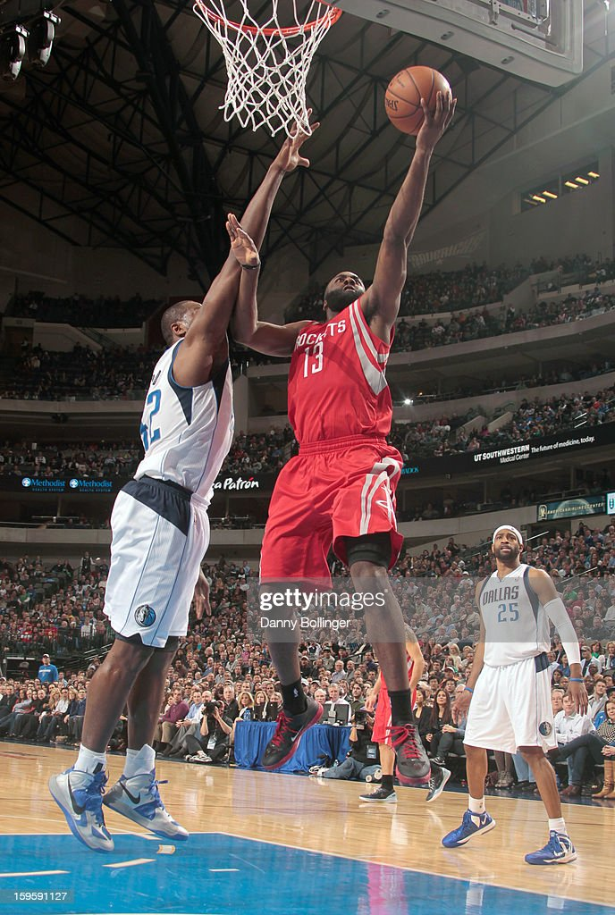 James Harden #13 of the Houston Rockets lays it up against Elton Brand #42 of the Dallas Mavericks on January 16, 2013 at the American Airlines Center in Dallas, Texas.