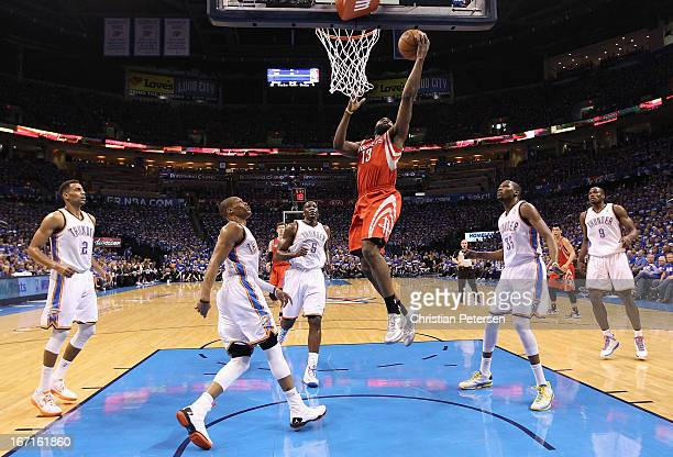 James Harden of the Houston Rockets lays up a shot past Russell Westbrook Kendrick Perkins and Kevin Durant of the Oklahoma City Thunder during the...