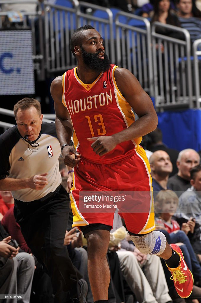 James Harden #13 of the Houston Rockets looks back after he hits a jump shot against the Orlando Magic during the game on March 1, 2013 at Amway Center in Orlando, Florida.
