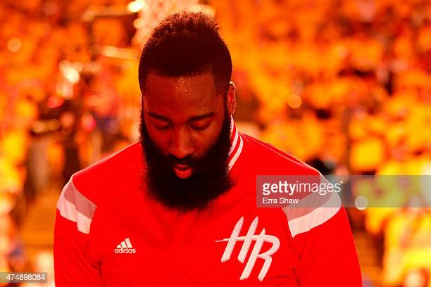 James Harden of the Houston Rockets looks down during the national anthem before before game five of the Western Conference Finals of the 2015 NBA...