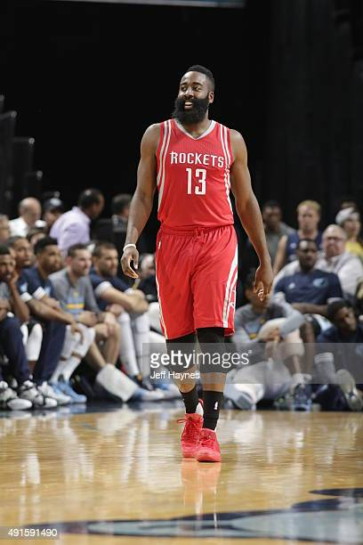 James Harden of the Houston Rockets looks on against the Memphis Grizzlies during a preseason game on October 6 2015 at FedExForum in Memphis...